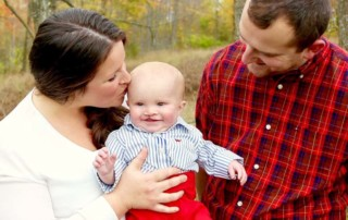 Parents and their baby who has a cleft palate
